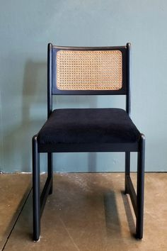 An upcycled dining room chair. The look of the cane contrast with the black is perfect. Check out how easy it is to upcycle a chair!
