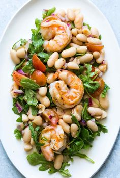 Quick and easy shrimp arugula salad with white beans and cherry tomatoes! Takes…