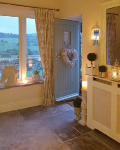 Stone flagged hallway ... chartwell green door...Danish   Lantern and wall sconce.... converted barn.