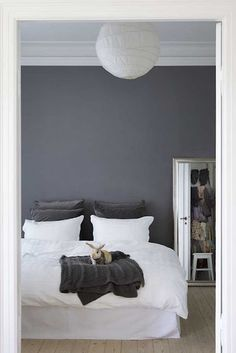bedroom with gray wall. A colored #saranoni on the bed instead would add just a little pop of color don't you think?