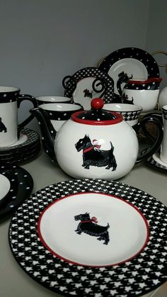 """SOME HOUNDS TOOTH PATTERN AND SOME DOT WITH SCOTTIE SCOTTISH TERRIER DOG. 1 SUGAR 1 SUGAR LID. 1 TEA POT. 1 TEA POT LID. 2 HOUNDS TOOTH MEDIUM PLATES 8.25 6 HOUNDS TOOTH SMALL PLATES. 2 POLKA DOT MEDIUM PLATES 8.25"""". 