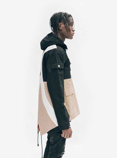 Side view shot of Fishtail Two-Tone Cargo Pocket Pullover in Black/Khaki on model