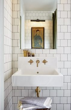 Little House Inspiration; wall-mount sink with brass fittings, white subway tile with dark grout