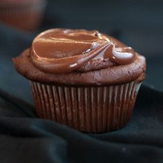 Brownie Batter Cupcakes. A dense brownie trapped inside a fudgy chocolate cupcake, capped with rich frosting.