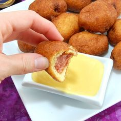 "Mini Corn Dogs recipe - ""Bite-sized hot dogs dipped in cornbread batter and fried to golden perfection. They are perfect for snacking, appetizers, parties and tailgating."" {beef dogs taste better but don't stick too well to the batter, turkey dogs stick well but taste bland}"