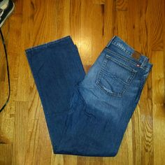 Lucky Brand Riley boyfriend jeans Lucky Brand Riley style boyfriend straight keg jeans in medium dark blue wash size 14/32. Inseam 31.5 inches. Front rise 9 inches. Waist measures 37 inches. These jeans are made to look distressed especially on the waist and pocket ares front and back. Minimal hem wear. See pics. Excellent condition. Lucky Brand Jeans Boyfriend