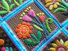 "The pattern is from Pieceocake's ""My Whimsical Quilt Garden"" book."