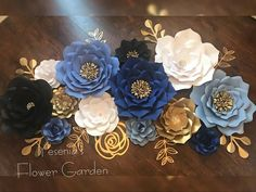 This beautiful paper flower set is perfect to decorate your event or use as home decor. This set can be recreated in your choice of colors, some premium colors may incur and up charge please check before ordering. Includes: 5 Large paper flowers (16-18) 4 Medium paper flowers (Medium - 12-14) 4 Small paper flowers (8-10) Set of leafs included as shown (size varies on style) Colors: your choice Leaf colors: your choice hanging backing included. This set included hand arranged acrylic gems.