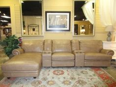 "Price: $1999.99 | Item #: 48234  5 piece sectional from Havertys in a tan leather. There is a coaster section between each seat. The ends recline as well! Great for a spacious living room. Perfect for hosting movie nights! 145""long x 67""deep x 33""high."