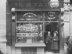 Men stand ouside a tobacco shop on the corner of O'Connell and Abbey Street, Dublin, Dublin Street, Dublin City, Old Pictures, Old Photos, Ireland Pictures, Vintage Photos, Tobacco Shop, Photo Engraving, Ireland Homes