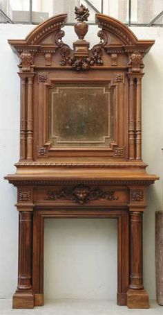 Walnut antique mantel with overmantel from the 19th century