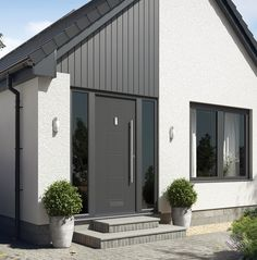 When searching for a Front Door you need to consider security that is as solid as a rock, door designs that are beautiful and excellent thermal efficiency. Value Doors are expert Rockdoor installers t Front Door Steps, Front Door Porch, Grey Front Doors, Modern Front Door, House Front Door, House Entrance, Entrance Doors, Front Porches, Barn Doors