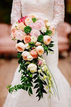 You can't go wrong with classic roses and peonies. Cascading greenery adds a vintage vibe.