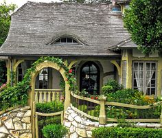 love the wavy roof line. looks storybookish.