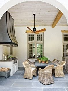 outdoor kitchen, real furniture/not outdoor furniture, wood beams, fan