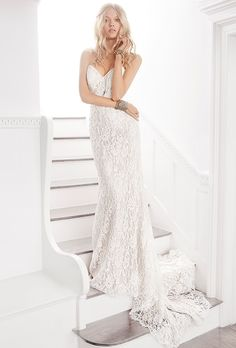 Ti Adora by Alvina Valenta. Ivory and champagne bridal sheath with a strapless sweetheart neckline and sheer center back skirt godet.