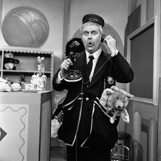 "American children's entertainer and executive producer Robert Keeshan (1927-2004) as Captain Kangaroo, talks on an old-fashioned candlestick telephone in a still from the beloved children's tv show, ""Captain Kangaroo"" in 1955."