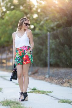 Classic white tank top paired with bright, tropical print shorts for the perfect summer look. #HelloGorgeous #ootd