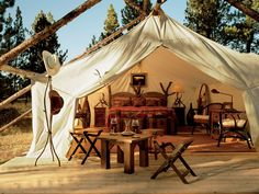 Go glamping (glamorous camping) at the Resort at Paws Up, a luxury retreated located on a 37,000-acre authentic working cattle ranch in western Montana. Description from businessinsider.com.au. I searched for this on bing.com/images