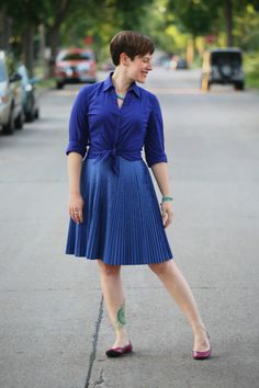 Already Pretty outfit featuring cobalt button-front shirt, pleated periwinkle skirt, magenta snakeskin flats, turquoise necklace