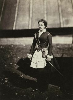A cantinière was a civilian woman attached to the French Army on an official basis, who sold food and liquor to the soldiers above and beyond what they received as rations. She had to be married to a soldier of the regiment, and received no pay, living off her earnings instead. This cantinière was attached to a zouave regiment (zouaves were originally Algerian troops), and therefore wears baggy trousers. Photo by Roger Fenton.