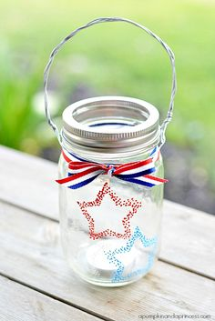 Red White Blue Hanging Mason Jar Votive - Fourth of July decorating ideas with mason jars - patriotic mason jar crafts for Fourth of July, Memorial Day, Labor Day, Flag Day ...