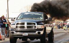 Black lifted Cummins Dodge Ram Diesel truck