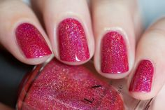 """Closure is a deliciously juicy apple red holographic nail polish stuffed with holographic incredibleness! There's absolutely nothing like a fresh coat of ultra sparkly red paint.   Yum!!  Closure is part of ILNP's new """"Ultra Holo"""" class of super intense holographic nail polishes; specifically formulated for maximum, in-your-face holographic sparkle!"""