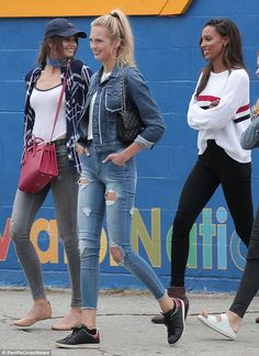 Models on the move! Victoria's Secret Angels (L-R) Taylor Hill, 20, Romee Strijd, 20, and Jasmine Tookes, 25, stepped out in Venice Beach in trendy street chic ensembles on Saturday