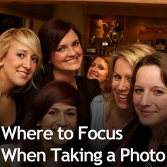 You want to focus on the eyes of the person closest to the camera. This is where you'll be drawn to first, and if it's not in perfect fous, then everything else is going to seem out of focus.    From here, the focus will gradually decreasenaturally.