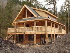log Dormer Construction | Slideshow of Machined Log Home Construction