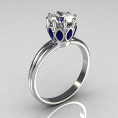 Marquise blue sapphire and a round cubic zirconia ring come together to create a tiara-like beauty.