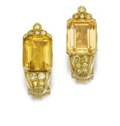 PAIR OF HELIODORE, TOPAZ AND DIAMOND EAR CLIPS, SUZANNE BELPERRON, 1970 - 1974 One set with a step-cut heliodore, the other with a step-cut topaz, both accented with brilliant- and single-cut diamonds of yellow tints, French assay and maker's marks for Darde et Cie.