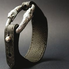 Bracelet | Manuel Bozzi. Camel leather and double snake handcrafted and engraved in sterling silver