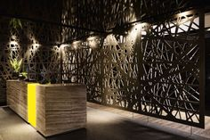 Laser cut backdrop at Reception by Source Interior Brand Architects @ Contemporist