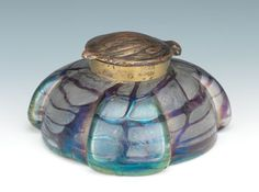Possibly Loetz, art glass inkwell with gilt metal acorn shaped hinged lid, stamped with number inside, glass unmarked. Clear glass with aubergine threading, the shaped vessel having three extensions. From Aspire Auctions