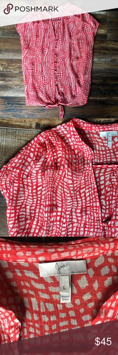 Joie silk top High low top and ties at waist in the front. 100% silk, sheer, armpit to armpit 25 in. 23 in shoulder to hem in front.  Sz large warm red and cream pattern. Joie Tops Blouses