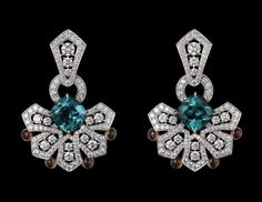 Oriental Influences – High Jewelry Earrings Platinum, two cushion-shaped blue tourmalines totaling 5.17 carats, cabochon-cut yellow sapphire...