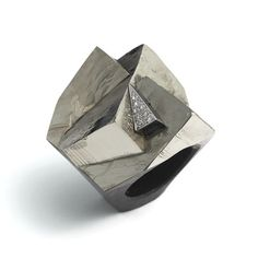 Grima Jewellery: Pyrite set on a base of dark Granite with pave-set Diamonds in White Gold