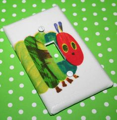 Switchplate made w Pottery Barn Kids Eric Carle The Very Hungry Caterpillar. $5.00, via Etsy.