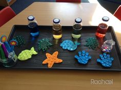 """Finger Gym with coloured water. Pipette the water into the sucker tops and tweeze out sequins onto the sucker tops. Inspired by Rache (,"""")! Finger Gym, Reception Class, Funky Fingers, Eyfs Classroom, Motor Activities, Fine Motor Skills, Projects To Try, Invitations, Reggio"""