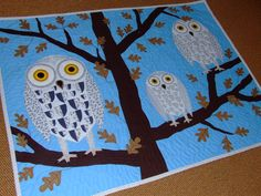 Wall hanging patchwork with snowy owl family sitting by gyorgyagi, $159.00