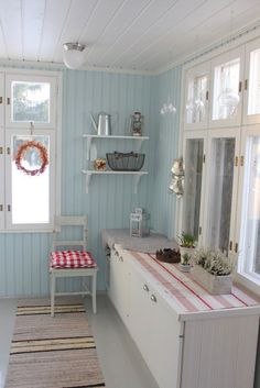 Blue and red summer house kitchen with a charming, homespun feel.