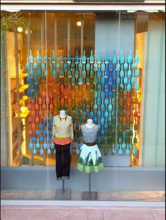 Colored paint brushes create abstract art for a front wind retail display | Pop Sugar