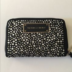Victoria's Secret iPhone wristlet.  Beautiful Victoria's Secret wristlet with rhinestones all over. Super cute and can hold an iPhone 5 and credit cards/ID and $$. Perfect for a night out.  Victoria's Secret Bags Clutches & Wristlets