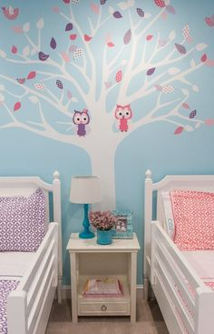 This shared big girl room features a tree wall decal that changes with the seasons @ Lisa Fero Interiors