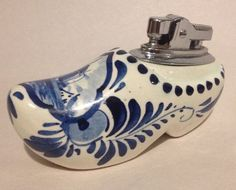 """Hand Painted with a Windmill scene with water and house and blue painted decorations. Also painted """"Holland"""". Made in Holland. bottom of lighter is PAT. Delft, Windmill, Flask, Lighter, Holland, Clogs, Vintage Items, Porcelain, Hand Painted"""