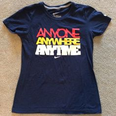 "Nike graphic t-shirt This Nike ""Anyone Anywhere Anytime"" t-shirt is navy blue in color and is a slim fit cut. It was only worn a couple of times and is in excellent condition. Nike Tops Tees - Short Sleeve"