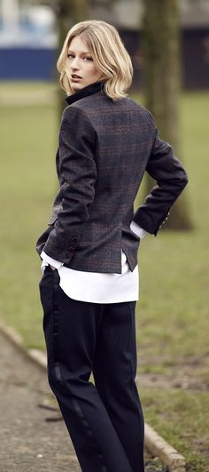 Nail the casual look with this checkered blazer,  black trousers and a white shirt hanging loosely over.