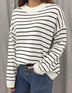 Get some cold weather comfort from this loose fit striped knit top!
